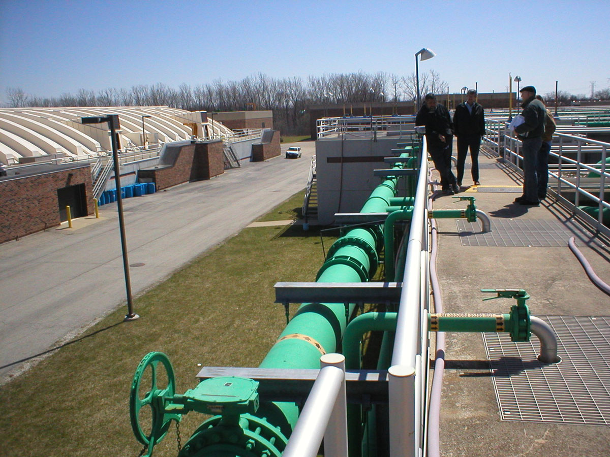People outdoors working at a water treatment plant